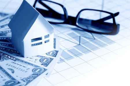 real estate market report concept with house on money and a graph